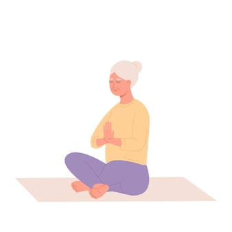 Old woman relaxing at yoga healthy lifestyle an elderly woman sits in a lotus position and meditat