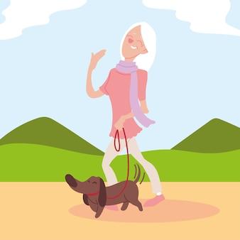 Old woman walks a dog in park, active senior design