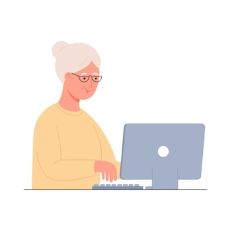 Old woman working on laptop computer online education web courses modern technologies