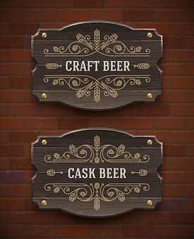 クラフトビールの繁栄のエンブレムと古い木製看板