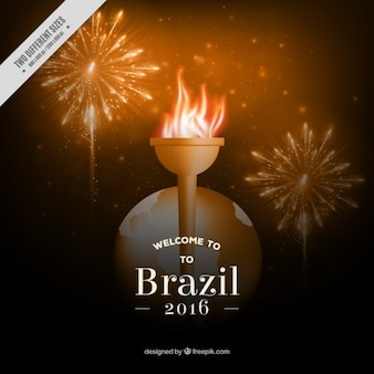 Olympic torch with firworks background