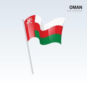 グレーに分離されたオマーンの旗を振っています。
