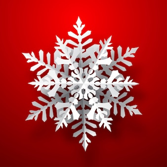 One big christmas paper snowflake with soft shadow, white on red background
