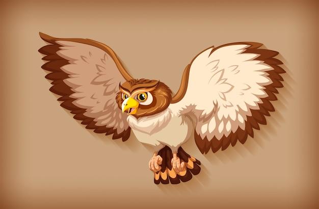 茶色の背景に飛んでいる1つの茶色のフクロウ