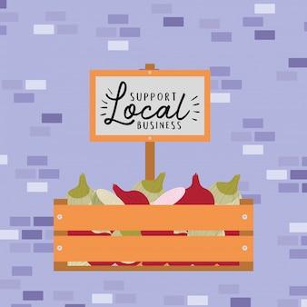 木製の箱の中に玉ねぎとバナーで地元のビジネスをサポート