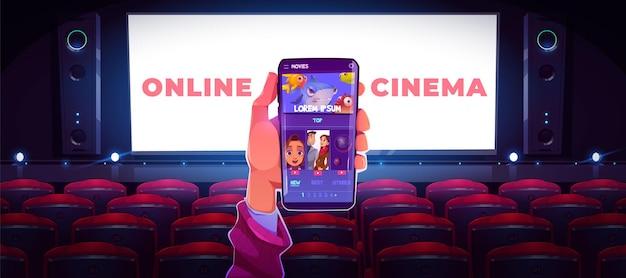 インターネットで映画を見るためのアプリケーションとスマートフォンを保持している人間の手でオンライン映画のコンセプト