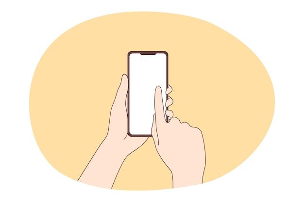 オンラインコミュニケーションとスマートフォンのコンセプトを使用しています。スマートフォンのタッチスクリーンと人間の手