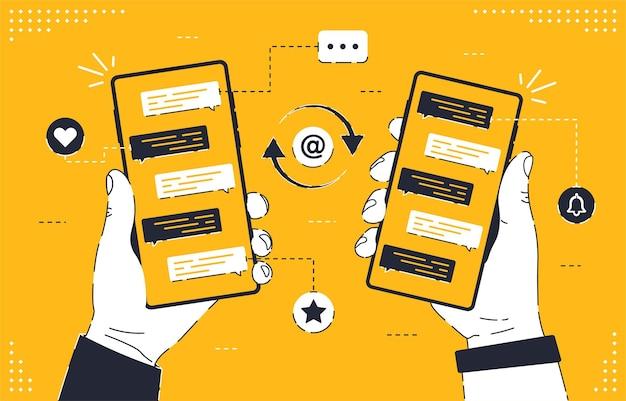 オンライン通信画面上のメッセージチャートとスマートフォンを持っている男性の手