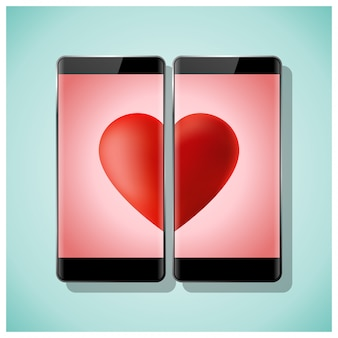 Online dating concept with two smartphones matching red heart on screen