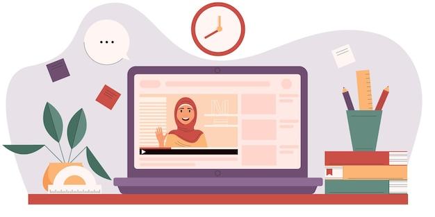 自宅でのオンライン教育デジタル教室ビデオ講義ノートパソコンの画面上のイスラム教徒の女性