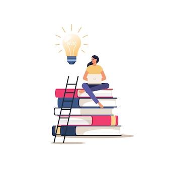 Онлайн-образование или курсы. девушка с ноутбуком сидит на книгах. концепция дистанционного обучения.