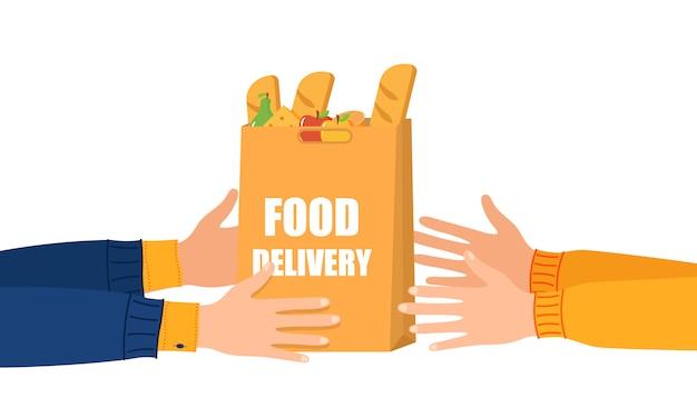 온라인 음식 배달. 손에는 식료품 제품으로 가득 찬 종이 쇼핑백이 있습니다. 코로나 바이러스 때문에 택배에서 고객에게 음식 배달. 격리 중 개념 온라인 식사 주문. .