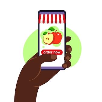オンライン食品注文。食料品の配達。ウェブブラウザページの製品カタログとスマートフォンを持っている手。外出禁止令。検疫または自己隔離。フラットスタイル。