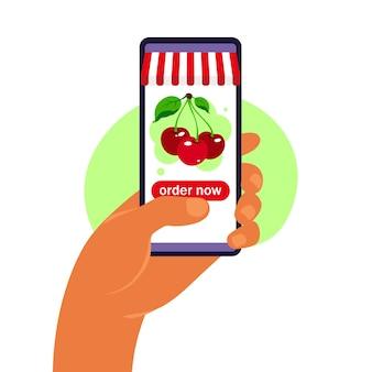 Заказ еды онлайн. доставка продуктов. рука смартфон с каталогом продукции