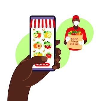 온라인 음식 주문. 식료품 배달. 제품 카탈로그와 함께 스마트 폰 들고 손