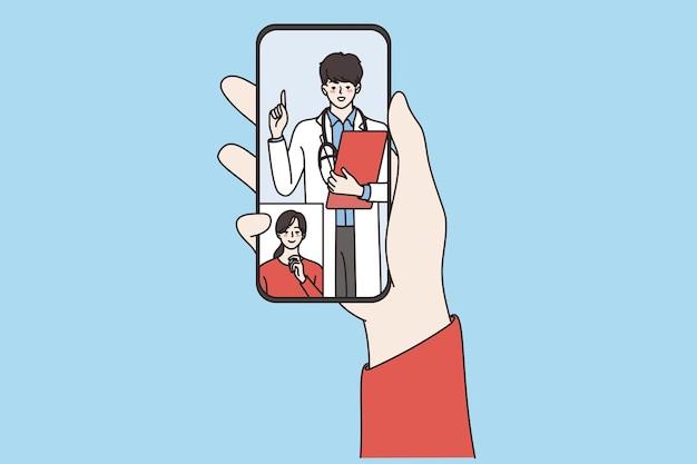 オンライン医療と遠隔医療の概念。画面のベクトル図から見ているオンライン笑顔の医師と女性患者とスマートフォンを保持している人間の手