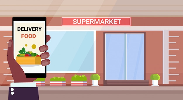 Online mobile application food delivery concept modern grocery shop supermarket exterior horizontal