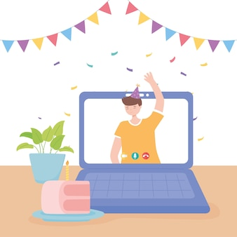 オンラインパーティー、ラップトップでビデオ通話で手を振っている若い男
