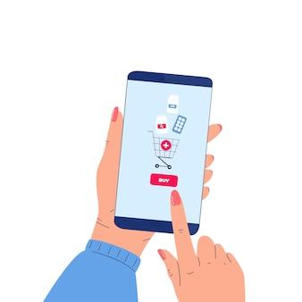온라인 약국. 여성의 손에 약을 구입하는 응용 프로그램과 함께 스마트 폰을 들고있다. 의약품 구매를위한 모바일 서비스입니다.