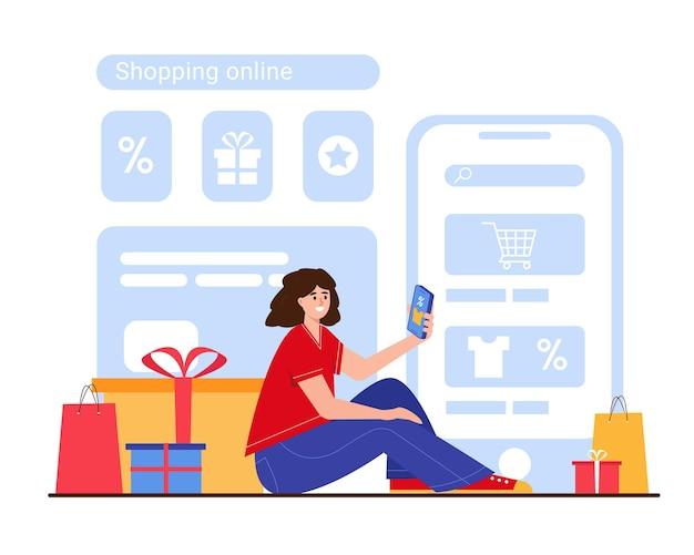 オンラインショッピングの大セールまたはブラックフライデーのコンセプトスマートフォンとボックスを持つ若い微笑む女性