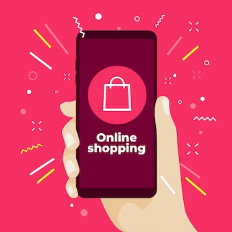Online shopping concept with hand holding smartphone.