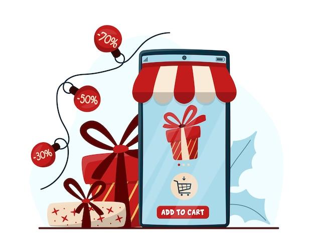 휴대 전화와 선물 상자가 있는 온라인 쇼핑 개념. 전자 상거래 온라인 상점, 디지털 마케팅 개념. 크리스마스와 겨울 세일. 전화 앱으로 크리스마스 쇼핑하기