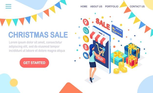 オンラインショッピングのコンセプト。女性はインターネットで小売店で購入します。クリスマスセールを割引します。 3dアイソメトリック携帯電話、お金のあるスマートフォン、クレジットカード、ギフトボックス、バッグ、パッケージ