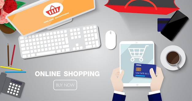 Online shopping sale with taplet by credit card on table