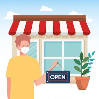 Открыт снова после карантина, человек с ярлыком открытия магазина, мы снова открыты, фасад магазина