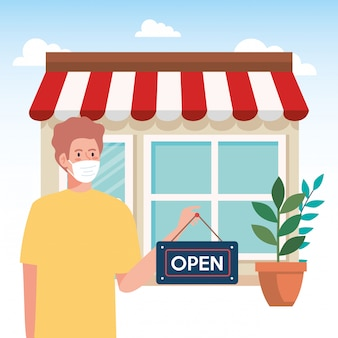 Open again after quarantine, man with label of reopening of shop, we are open again, store shop facade