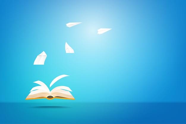 Открытая книга и творческий бумажный самолетик совместной работы. воображение для образования, идеи и концепции обучения.