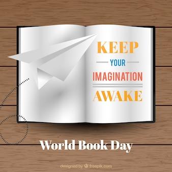 Sfondo libro aperto con il messaggio e aeroplano di carta