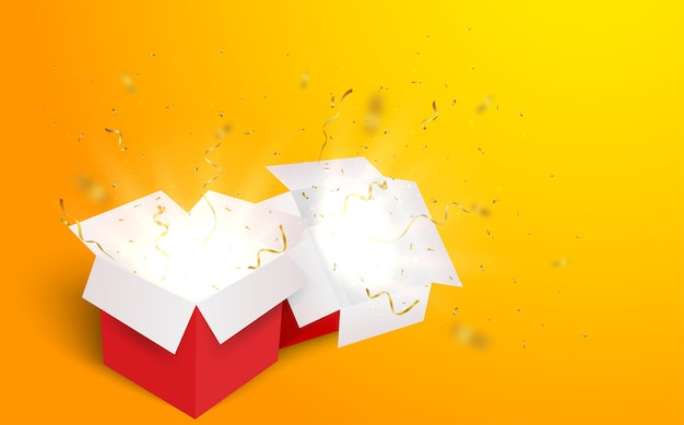 Open box with gold and red confetti  isolated