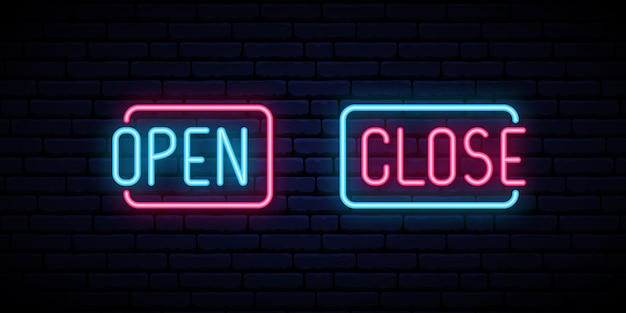 Open and close neon iscription on brick wall background.