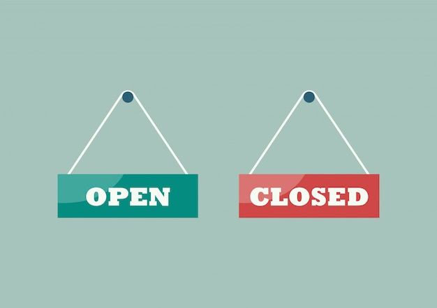Open and closed signs hanging plates