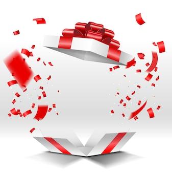 Открытая подарочная коробка с конфетти на белом фоне
