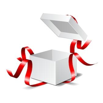 赤い弓でギフトボックスを開きます。白い背景で隔離