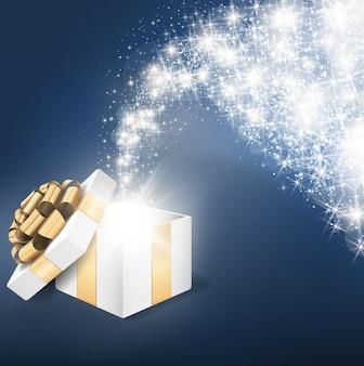 Открытая подарочная коробка с блестящим звездным светом