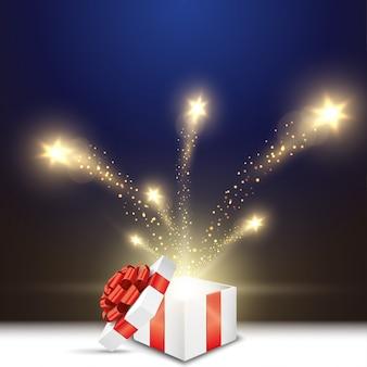 Открытая подарочная коробка с блеском звездного света