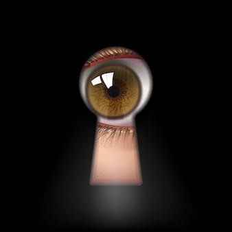 Открытый человеческий глаз в замочной скважине