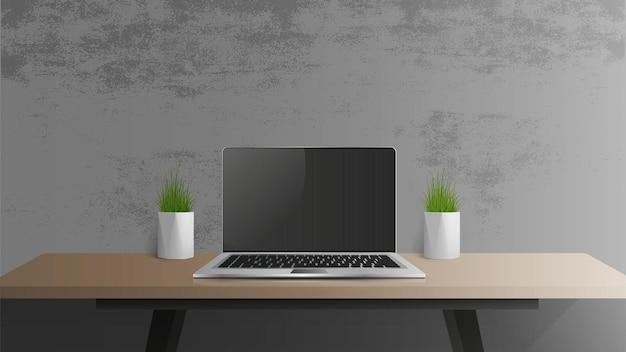 黒い画面でラップトップを開きます。木製のテーブルの上の現代のラップトップ。テーブル、デスクトップの緑の植物、ロフトスタイルの職場。