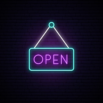 Open neon sign in a frame.