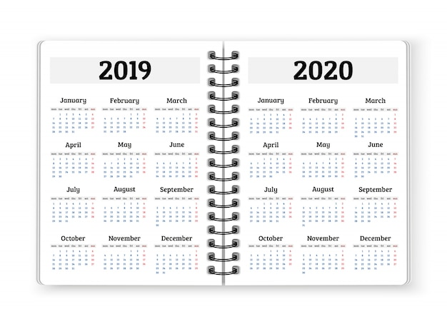 Open notebook paper with calendars for 2019, 2020 years background