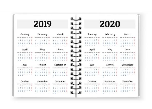2019年、2020年の背景のカレンダーでノートブック紙を開く