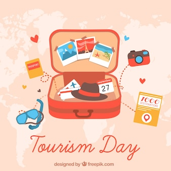 Open suitcase with travel items, world tourism day