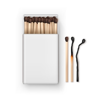 Opened blank box of brown matches with burned match isolated, top view on white