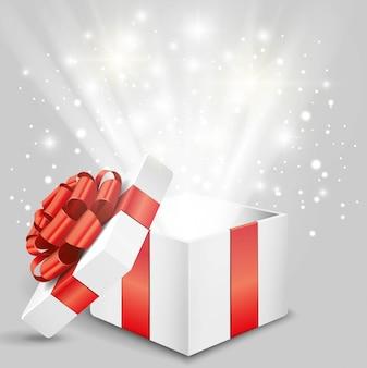 Открытая подарочная коробка с красным бантом и огнями