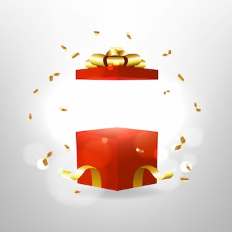 Opened red gift box with red bow and gold ribbon.