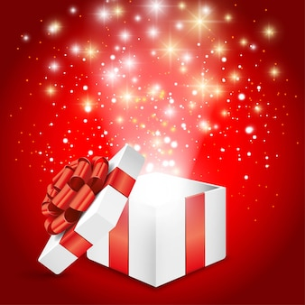 Открытая белая подарочная коробка с красным бантом и светящимися огнями