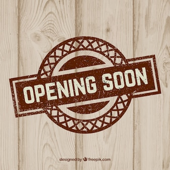 Opening soon with wood background